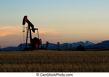 Oil pump - Oil and gas industry. Silhouette of oil pump...