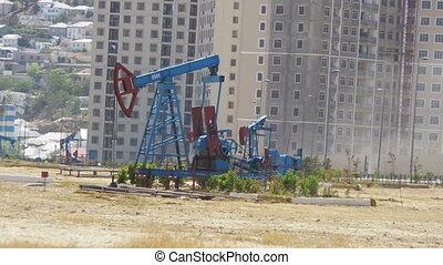 Oil Pump, Pump jack. Fossil Fuel Energy, Old Pumping Unit -...