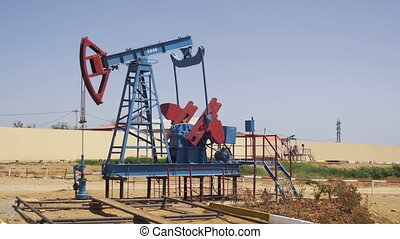 Oil Pump, Pump jack. Fossil Fuel Energy, Old Pumping Unit -...