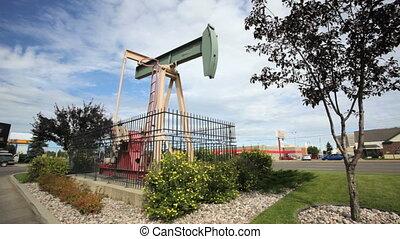 Pumpjack pumping oil in downtown Edmonton, Alberta