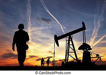 Oil pump silhouette at sunset