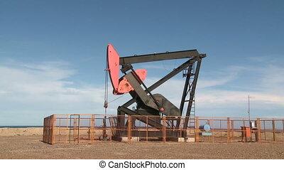 Oil pump - Oil pump against blue sky. Santa Cruz, Argentina...