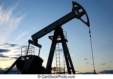 Oil pump - Silhouette pump jack on a blue sunset sky...