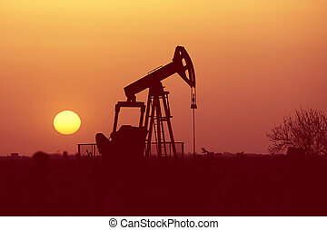 Oil pump at sunset, oil industry equipment