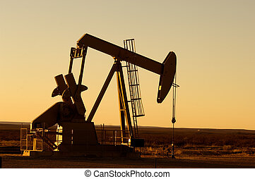 Working oil pump in rural Texas at sunset