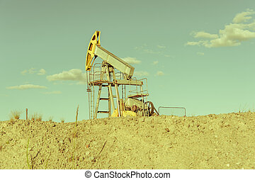 Oil pumpjack, industrial equipment. Extraction of oil. Petroleum concept.