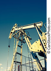 Oil pumpjack, industrial equipment. Rocking machines for power generation. Extraction of oil.