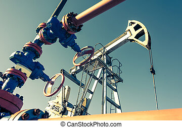Oil pumpjack, industrial equipment. Rocking machines for power genertion. Extraction of oil.