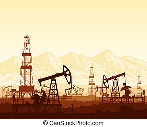 Oil pumps and drilling rigs over mountains
