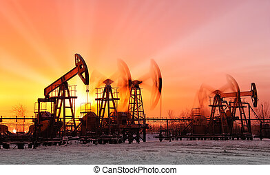 oil pumps at sunset sky background