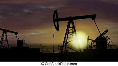Oil pumps - oil extraction on sunset background 3 - Working...