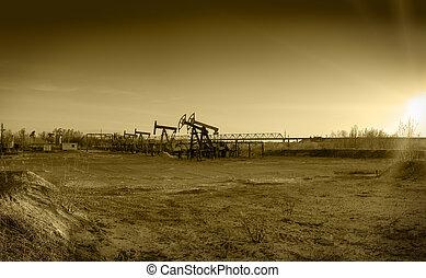 Oil pumps on a oil field.