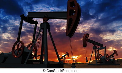 Oil pumps on sunset background