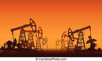 Oil pumps over sunset.