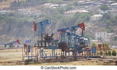 Oil Pumps, Pump jack. Fossil Fuel Energy, Old Pumping Unit -...