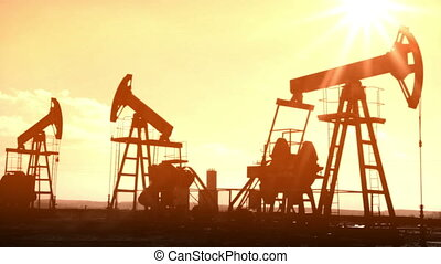oil pumps silhouette - old movie styled timelapse