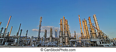 Oil rafinery - Giant oil refinery with chimnies by the...