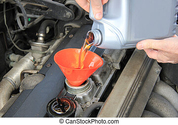 Oil refill - Man checking engine oil of an older car