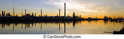 Oil Refinary at dusk - An oil refinary, located in the huge...