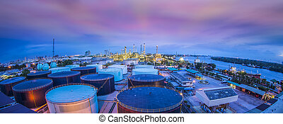 Landscape of oil refinery industry with oil storage tank