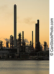 Oil refinery at sunset