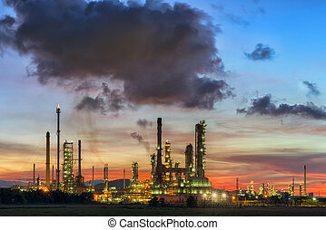 Oil refinery at sunset sky.