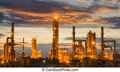 Oil refinery factory with sunrise background, Pipe, oil tank...