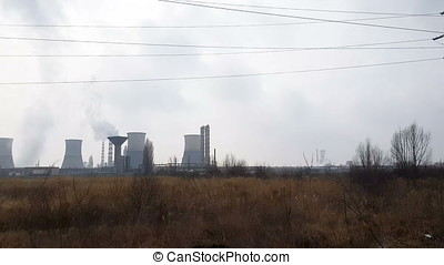 Oil refinery hevily polluting the enviroment. Shot from the...