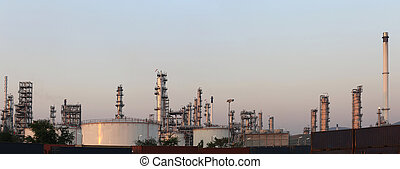 Oil refinery in the evening of panorama style.