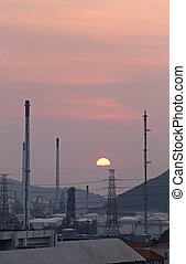 Oil refinery in the evening, photography on sunset.