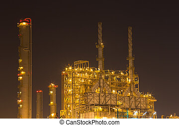 Oil refinery industrial plant at night
