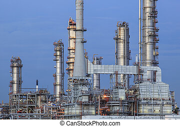 oil refinery palnt against dusky blue sky in petrochemical industry estate