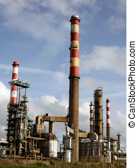 Oil refinery - Part of a big oil refinery with many red and...