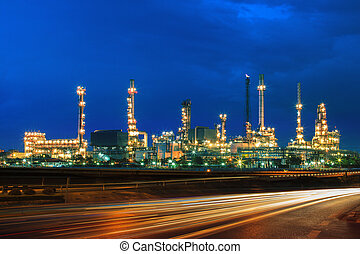 oil refinery plant against beautiful blue dusky sky and vehicle