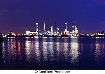 Oil refinery plant along river in Bangkok