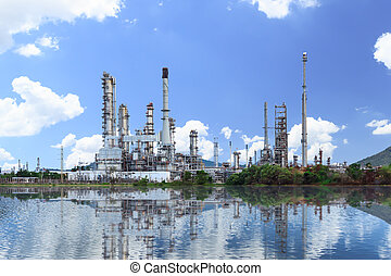 Oil refinery plant along the river with reflection