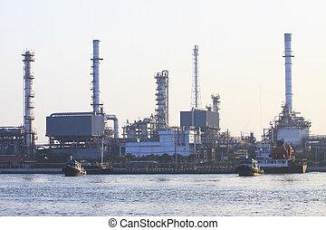 oil refinery plant beside river in morning light