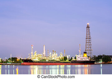 Oil refinery plant with tanker night - landscape of Oil...
