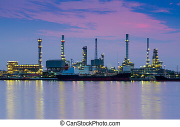 Oil refinery reflected