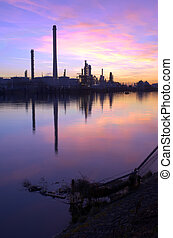 Oil Refinery Sunset - An oil refinery, situated in a...