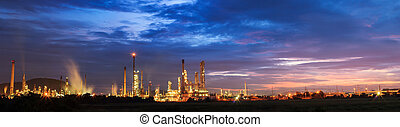 oil refinery with sunrise or twilight in panorama.