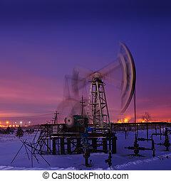 Oil rig at night.