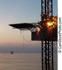 Oil rig before sunrise in Persian Gulf