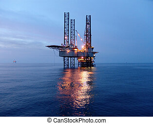 Oil rig before sunrise - Offshore oil rig in the Gulf