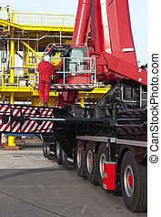 Oil rig construction - Construction workers, operating a...