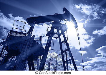 Pump jack. Extraction of oil. Toned blue.