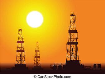 Oil rigs over sunset.