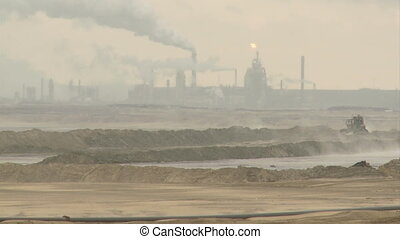 Oil sands plant and tailings pond - Oil sand processing...