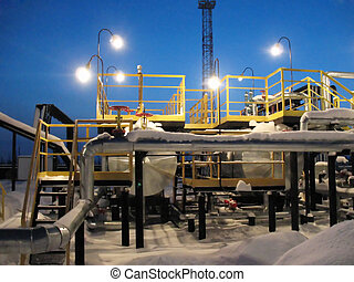 Oil scene - Gas pipeline on a refinery center. Work of oil...