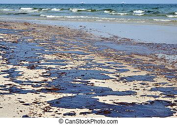 Oil spill on beach.